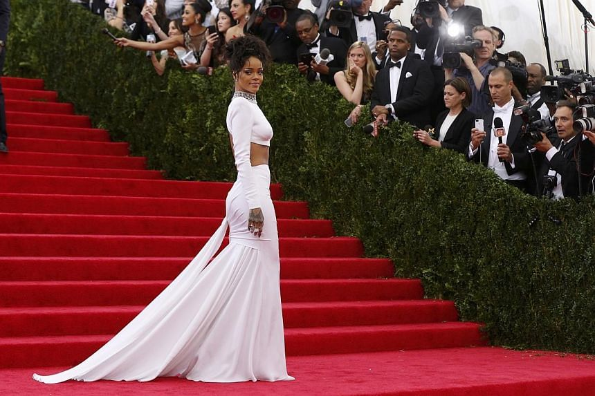 HOT OR NOT: Singer Rihanna was all glammed up in her all-white, midriff-showing and back-baring Stella McCartney dress. The up-do completed the classy look. -- PHOTO: REUTERS