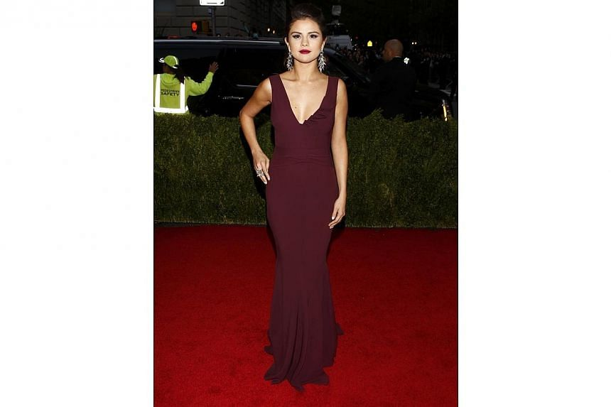 HOT OR NOT: Actress and singer Selena Gomez looked all grown up in a simple yet elegantly cut Diane von Furstenberg gown. -- PHOTO: REUTERS