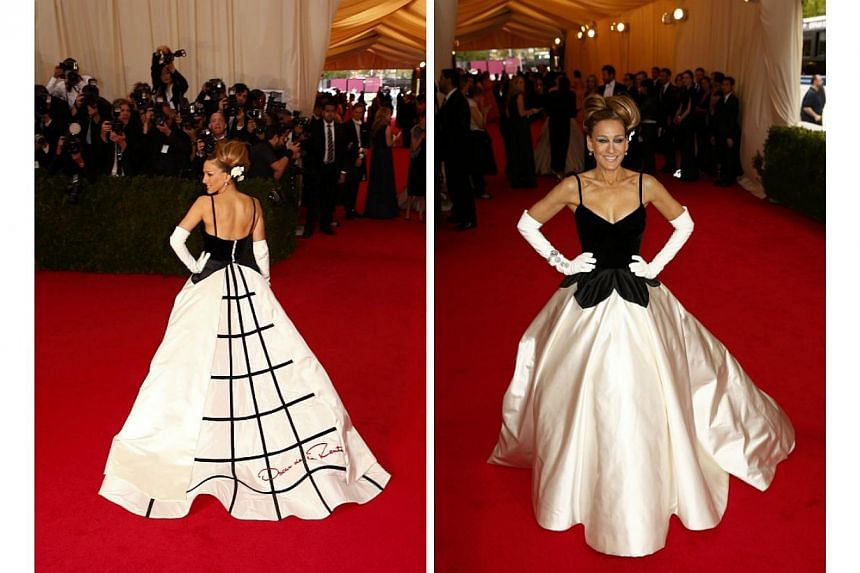 HOT OR NOT: For some reason, Sarah Jessica Parker felt the need to let the world know she was wearing an Oscar de la Renta gown. The designer's signature was very visible on the train of her dress at the 2014 Met Gala. Do you approve? -- PHOTO: REUTE