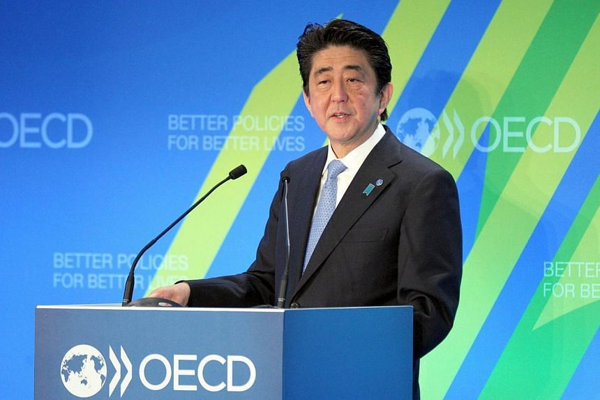 Japanese Prime Minister Shinzo Abe addresses the OECD assembly on May 6, 2014 at the OECD headquarters in Paris, as part of the French stage of his six-nation European tour for trade and security talks. Japan and the United States will work toge