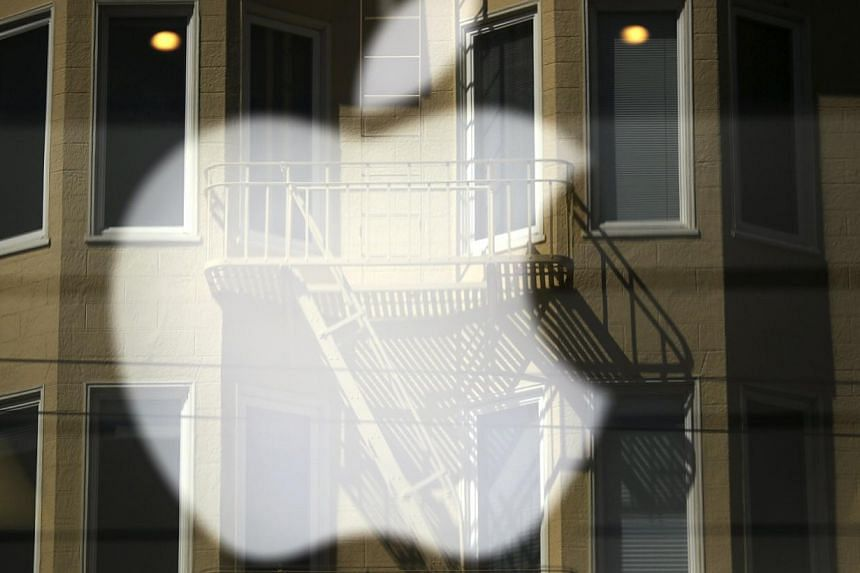 Apple shares on Monday climbed above US$600 ahead of a stock split and as the company ramps up its stock buy-back programme. -- FILE PHOTO: REUTERS