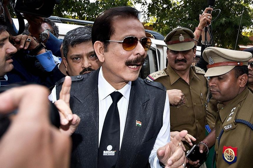 India's Sahara group chairman Subrata Roy (centre) speaks to the media as he arrives at the Supreme Court in New Delhi on March 4, 2014. India's Supreme Court on Tuesday, May 6, 2014, rejected an appeal to release Sahara conglomerate Chairman Su