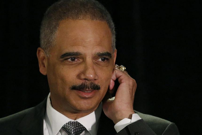 """United States Attorney General Eric Holder speaks at the National Association of Attorneys General in Washington on May 5, 2014. US Attorney General Eric Holder has warned that no financial institution should consider itself """"above the law,"""" amid inv"""