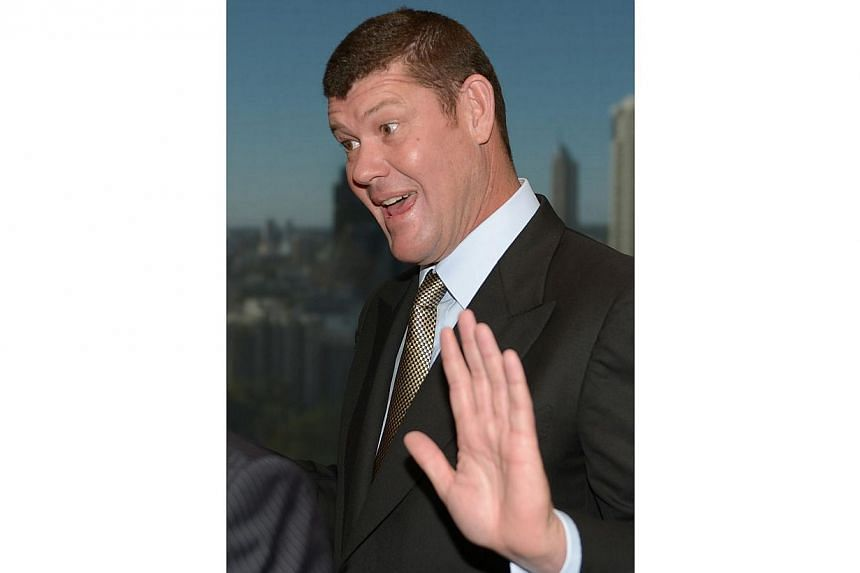 This file photo taken on July 23, 2013 shows Australian billionaire gambling tycoon James Packer gesturing as he speaks with a guest at the launch of the Harper Collins published book Killing Fairfax in Sydney. -- FILE PHOTO: AFP