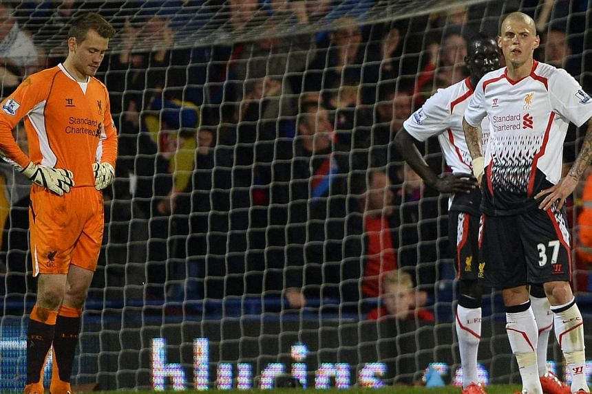 Liverpool players react after Crystal Palace score an equalising goal during their English Premier League soccer match at Selhurst Park in London on May 5, 2014. -- PHOTO: REUTERS