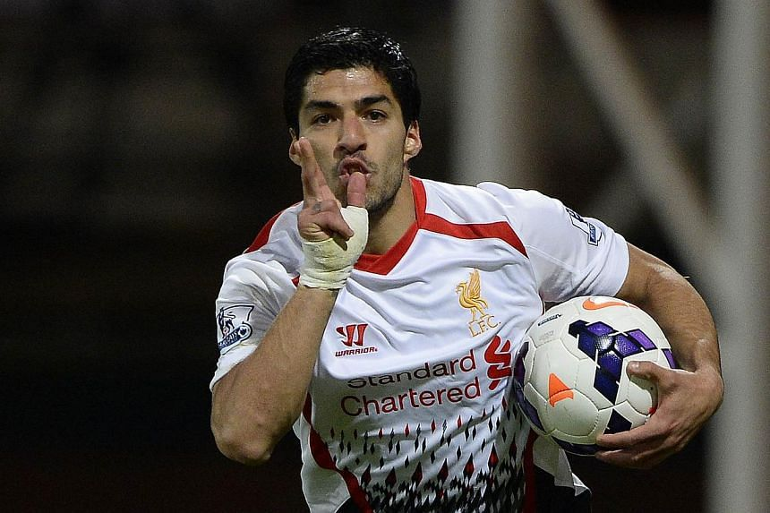 Liverpool's Luis Suarez celebrates after scoring a goal against Crystal Palace during their English Premier League football match at Selhurst Park in London on May 5, 2014. Luis Suarez equalled the Premier League goal-scoring record for a 38-game sea