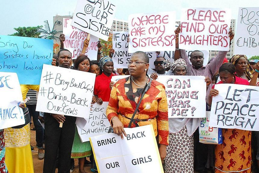 Former Nigerian Education Minister and Vice-President of the World Bank's Africa division (centre) Obiageli Ezekwesilieze leads a march of Nigeria women and mothers of the kidnapped girls of Chibok, calling for their freedom in Abuja on April 30, 201