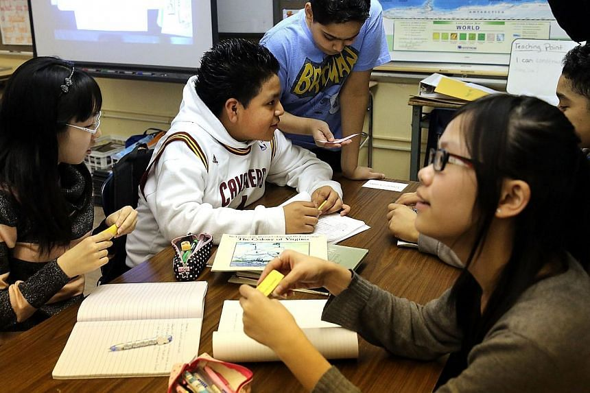 Students at J.H.S. 088 Peter Rouget school in Brooklyn on April 7, 2014. Asian-American schoolchildren tend to outperform their white counterparts in school because they try harder, according to a US study out Monday.-- FILE PHOTO: AFP