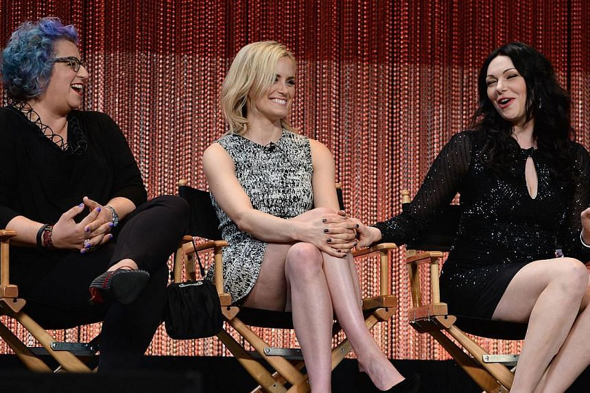(Left to right) Executive producer and creator Jenji Kohan with actors Taylor Schilling and Laura Prepon on stage at The Paley Center For Media's PaleyFest 2014 Honoring Orange Is The New Black at Dolby Theatre on March 14, 2014 in Hollywood, Califor