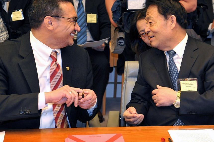 Malaysia's Acting Transport Minister Hishammuddin Hussein (left) speaking to his Chinese counterpart Yang Chuantang in Canberra yesterday. A panel of aviation experts is expected to meet tomorrow to sift through all known data on the MAS plane's flig