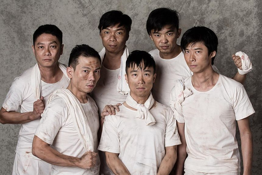 Playing the prisoners in Senang are (clockwise from back row left) Ong Kian Sin, Tay Kong Hui, Rei Poh, Neo Hai Bin, Oliver Chong and Peter Sau. -- PHOTO: TAN NGIAP HENG FOR DRAMA BOX
