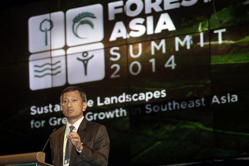 "Environment and Water Resources Minister Vivian Balakrishnan at the Forests Asia Summit in Jakarta yesterday. The root of issues like the haze is ""misaligned commercial interests"", he says."