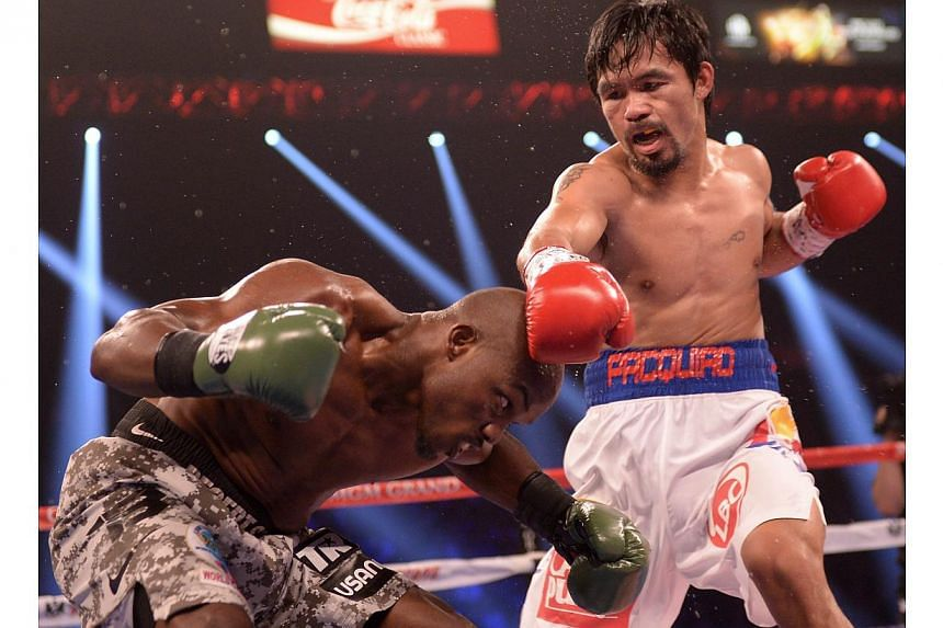 Timothy Bradley (left) of US defends against Manny Pacquiao of Philippines (right) during their WBO World Welterweight Championship title match at the MGM Grand Arena in Las Vegas on April 12, 2014. -- FILE PHOTO: AFP