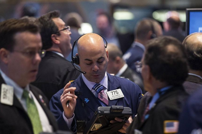 Traders work on the floor of the New York Stock Exchange on April 24, 2014. US stocks finished higher on Monday after struggling to get out of the losing column, shrugging off poor industrial data from China and growing violence in Ukraine. -- F