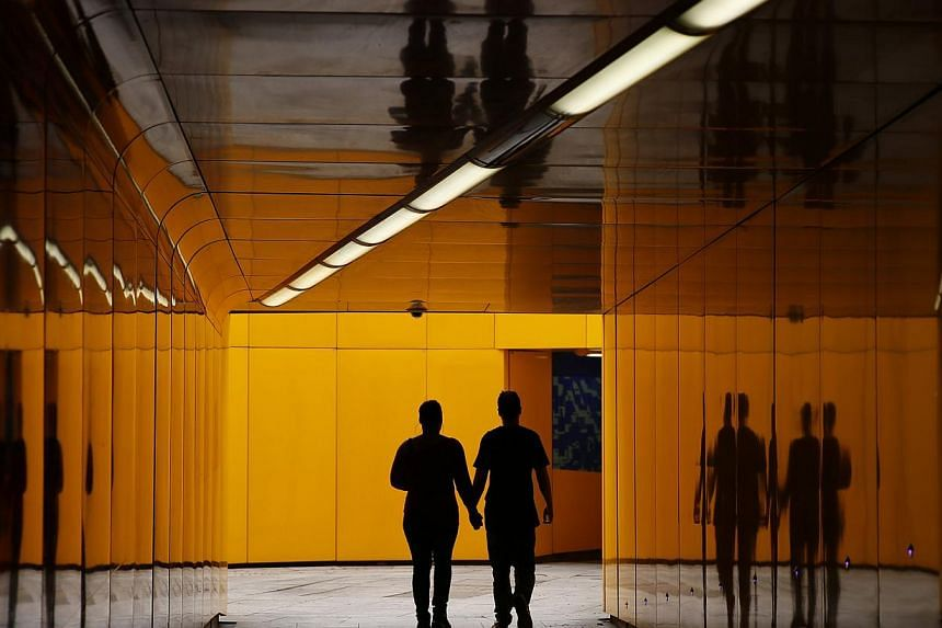 A couple are silhouetted in an underpass in London on May 5, 2014. -- PHOTO: REUTERS