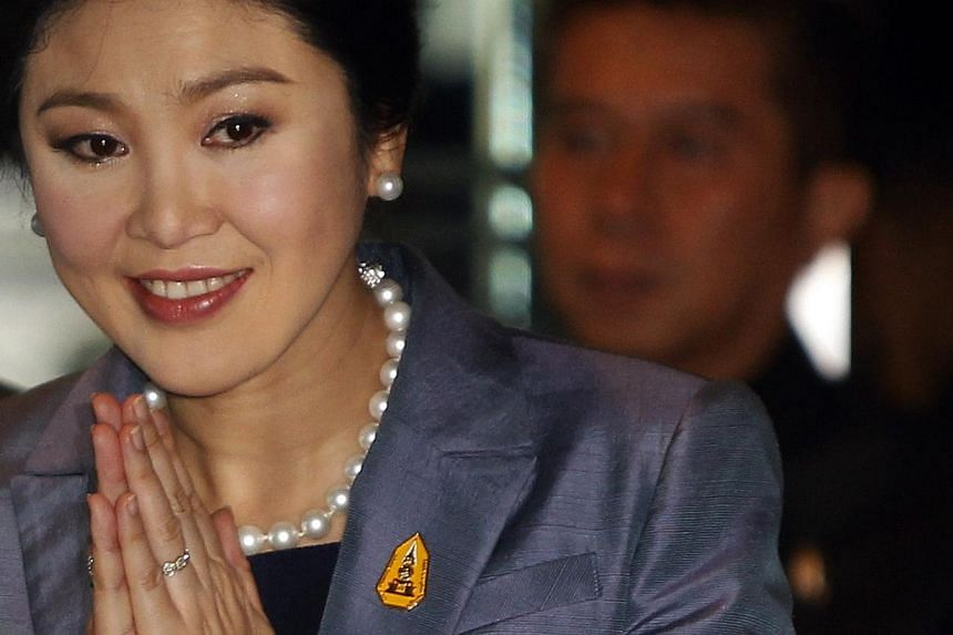Thailand's Prime Minister Yingluck Shinawatra arrives at the Constitution court in Bangkok on May 6, 2014. Thailand's besieged Prime Minister Yingluck Shinawatra denied an abuse of power allegation at the nation's Constitutional Court on Tuesday in a