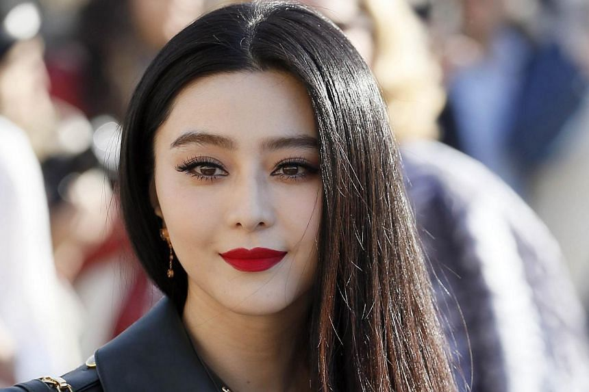 Chinese actress Fan Bingbing poses upon arrival prior to attend Louis Vuitton 2014/2015 Autumn/Winter ready-to-wear collection fashion show, on March 5, 2014 in Paris. -- PHOTO: AFP