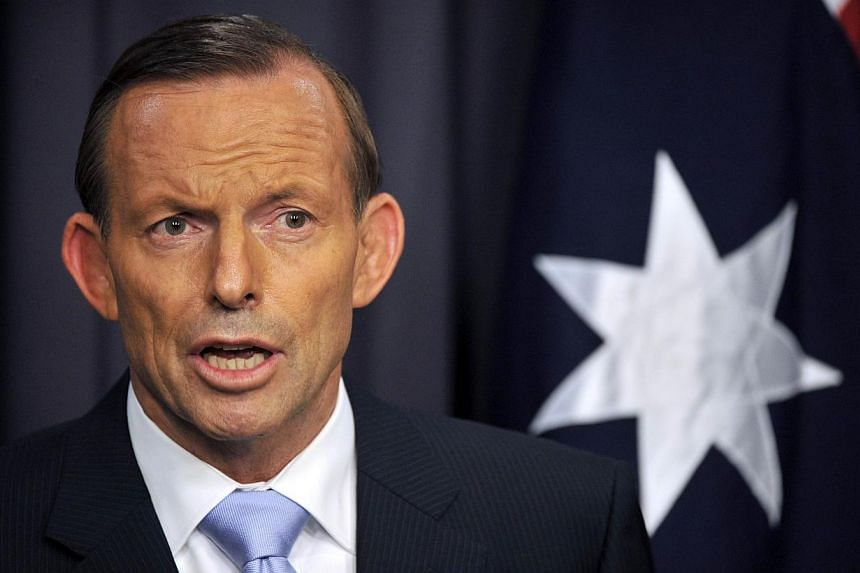 Australian Prime Minister Tony Abbott called the Indonesian president on Tuesday to express regret after axing a trip to Bali reportedly due to fears an asylum boat turn-back could inflame tensions, Jakarta said. -- FILE PHOTO: AFP
