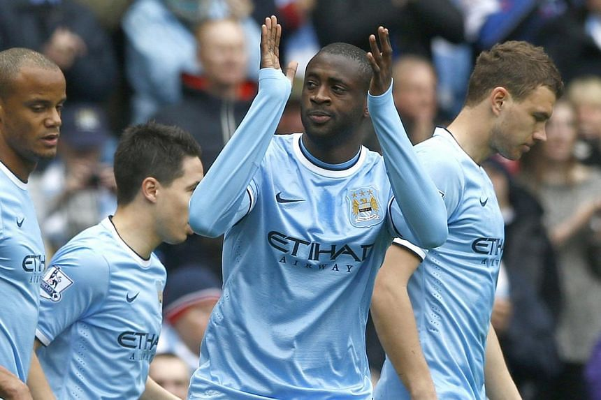 Manchester City's Yaya Toure celebrates after scoring a penalty during their English Premier League soccer match against Southampton at the Etihad stadium in Manchester, northern England on April 5, 2014. Paris St-Germain and Manchester City face fin