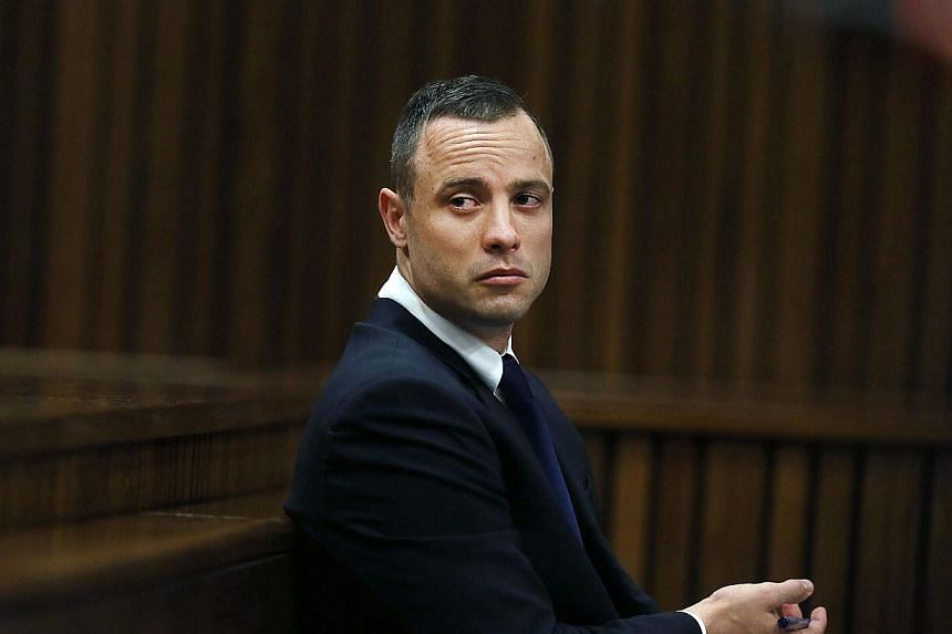 South African Paralympian sprinter Oscar Pistorius sits in the dock during the testimony of a defence witness at his murder trial at the high court in Pretoria on May 6, 2014. Pistorius introduced Reeva Steenkamp as his fiancee just a week before he