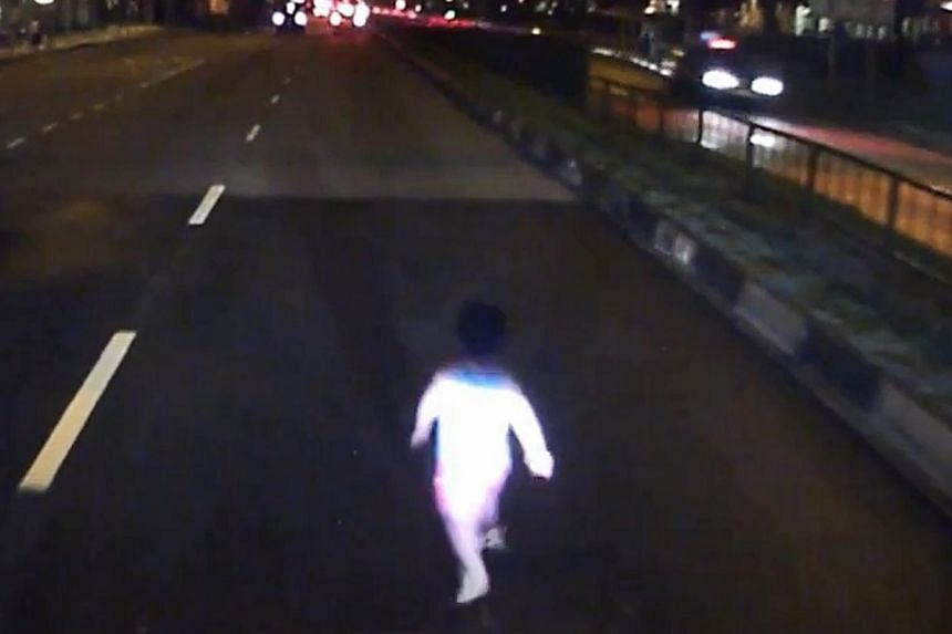 A video of a toddler nearly run over by two vehicles after he ran across a road has gone viral. -- PHOTO: SCREENGRAB FROM STREETDIRECTORY/FACEBOOK