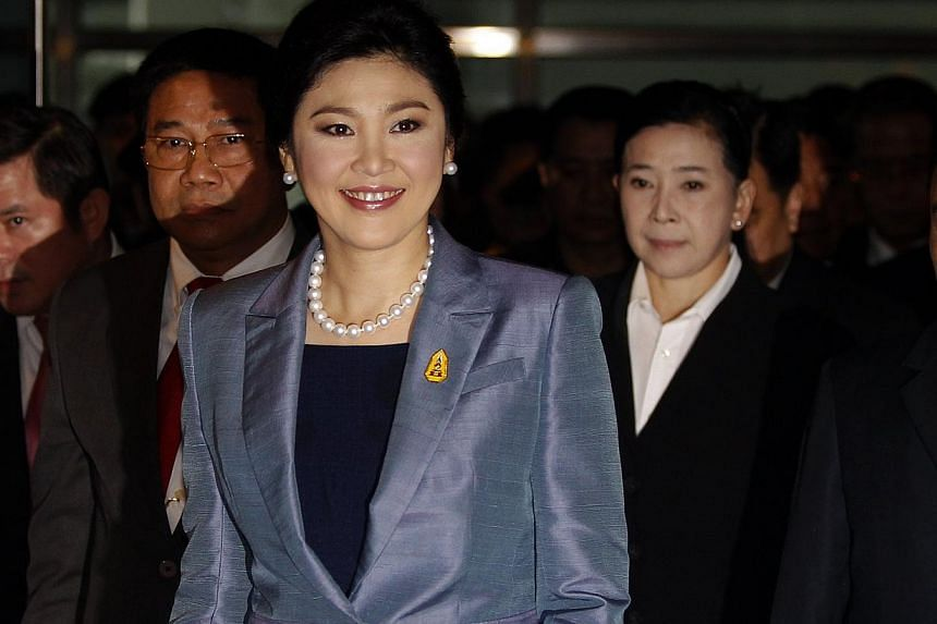 Thailand's Prime Minister Yingluck Shinawatra smiles as she arrives at the Constitutional Court in Bangkok on May 6, 2014. Thailand's Constitutional Court said on Tuesday it would hand down a ruling on May 7 in an abuse of power case brought against