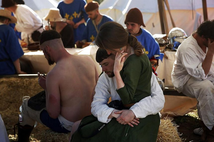 Members of the French team rest at their camp after competing during the Medieval Combat World Championship in Belmonte, Spain on May 2, 2014. -- PHOTO: REUTERS
