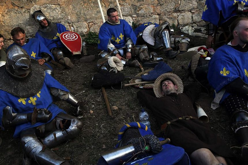 Members of the French team rest after competing during the Medieval Combat World Championship in Belmonte, Spain on May 1, 2014. -- PHOTO: REUTERS