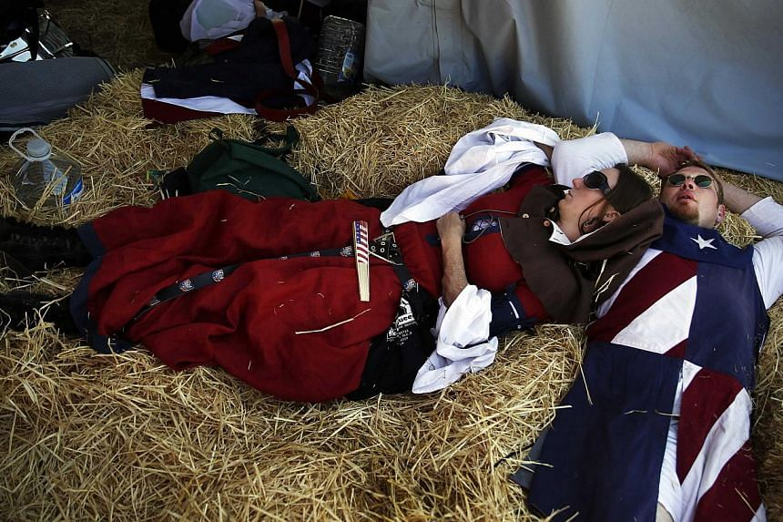 Members of the United States team rest in their tent during the Medieval Combat World Championship in Belmonte, Spain on May 1, 2014. -- PHOTO: REUTERS