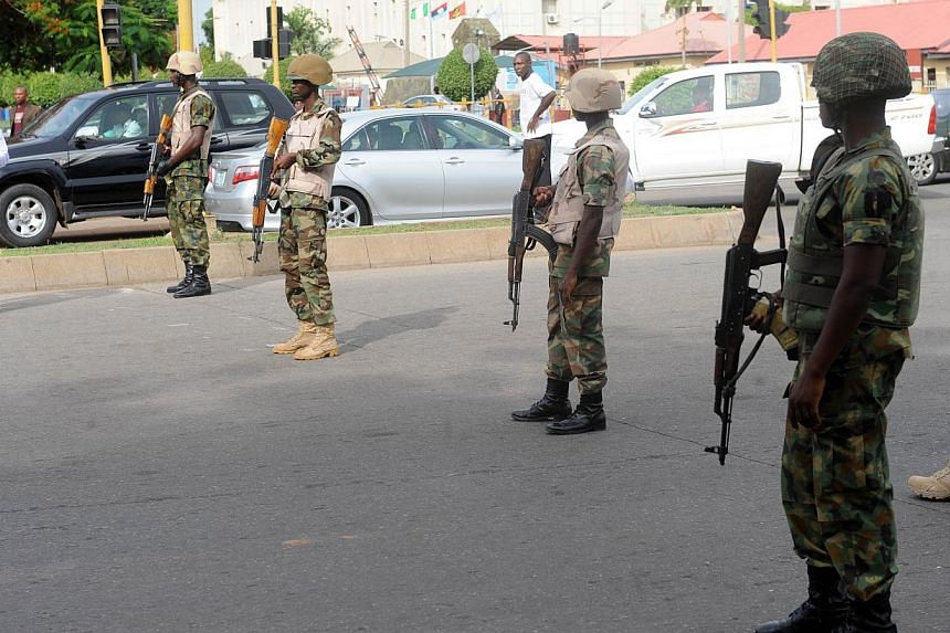 Soldiers block the road to stop the advancing civil society groups protesting the abduction of Chibok school girls during a rally pressing for the girls' release in Abuja on May 6, 2014, ahead of World Economic Forum. -- PHOTO: AFP