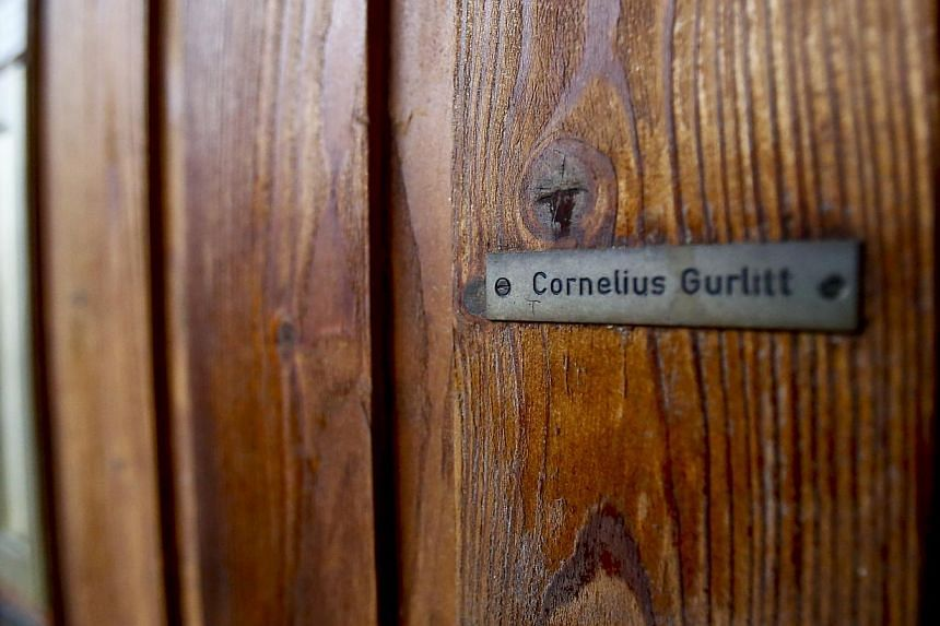 File photo of the name plate on the house of art collector Cornelius Gurlitt in Salzburg. -- PHOTO: REUTERS