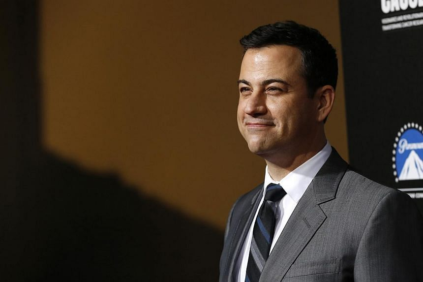 Television host Jimmy Kimmel poses at the second annual Rebels With a Cause gala at Paramount Pictures Studios in Los Angeles, California on March 20, 2014. Jimmy Kimmel's late night show Jimmy Kimmel Live! has been extended for two more years