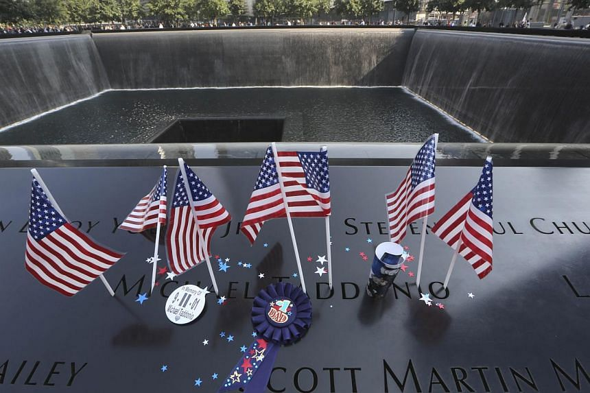 A file picture taken on Sept 11, 2013 shows the south reflecting pool of the 9/11 Memorial decorated during a ceremony in New York. Thousands of unidentified remains from victims of the September 11, 2011 attacks in New York will be taken Saturday to