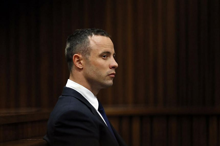 Olympic and Paralympic track star Oscar Pistorius sits in the dock in the North Gauteng High Court in Pretoria on May 6, 2014. Pistorius is on trial for murdering his girlfriend Reeva Steenkamp at his suburban Pretoria home on Valentine's Day last ye