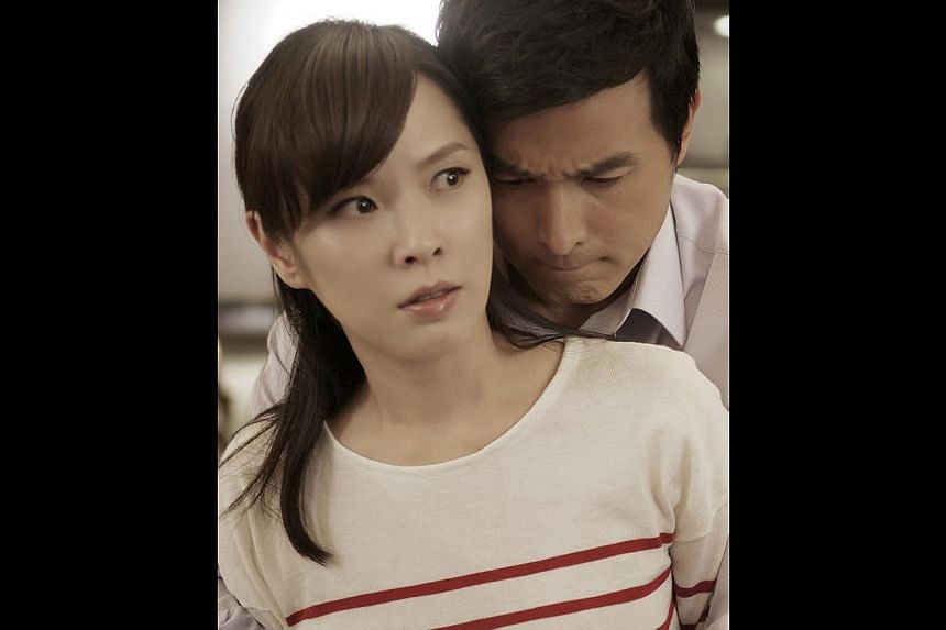 In this Taiwanese drama, Lee plays a workaholic husband who neglects his wife (played by Taiwanese sex bomb Tian Xin, both above), who eventually has an affair. -- PHOTO: TAIWAN TELEVISION ENTERPRISE (TTV)