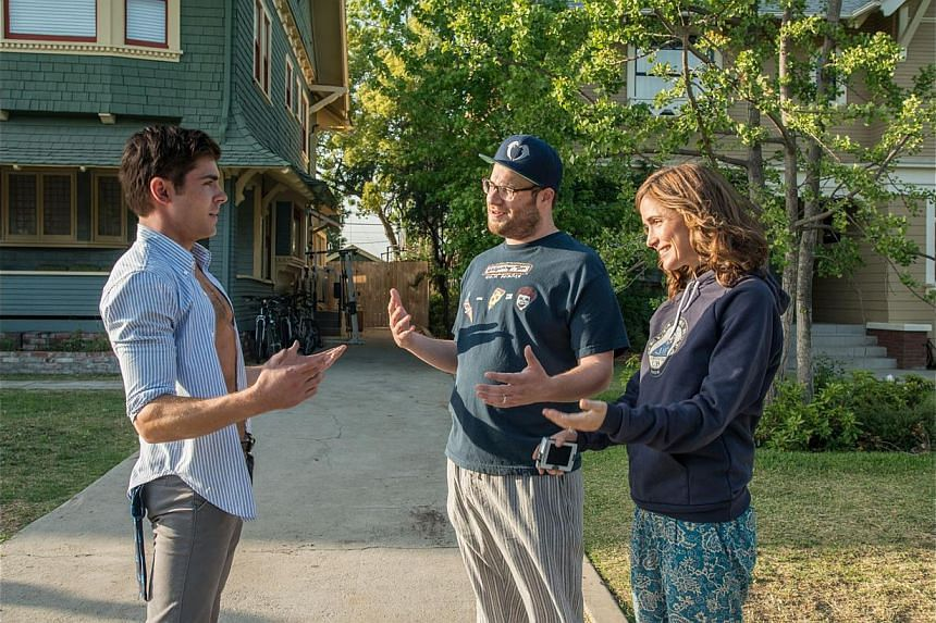 Bad Neighbours pits a men's fraternity headed by Zac Efron's charismatic Teddy (left) against new parents Seth Rogen (centre) and Rose Byrne (right).