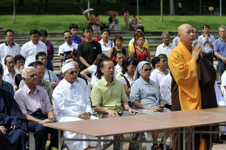 Former foreign minister George Yeo (in green shirt) and religious representatives gathered at Bedok Reservoir for a prayer session in 2011. Inter-religious dialogue is not exclusively for the religious elite, says the writer. Dialogue in its simple f