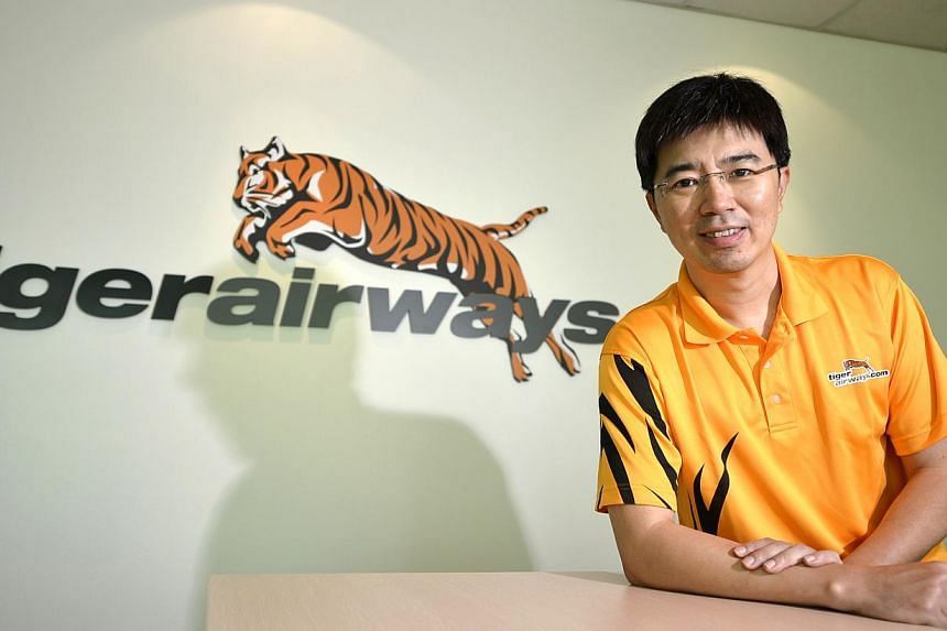 Singapore's Tiger Airways Holdings said it would be replacing CEO Koay Peng Yen (above) with Lee Lik Hsin, an executive from its largest shareholder Singapore Airlines, days after the budget carrier reported a big widening in its losses. -- ST FILE P