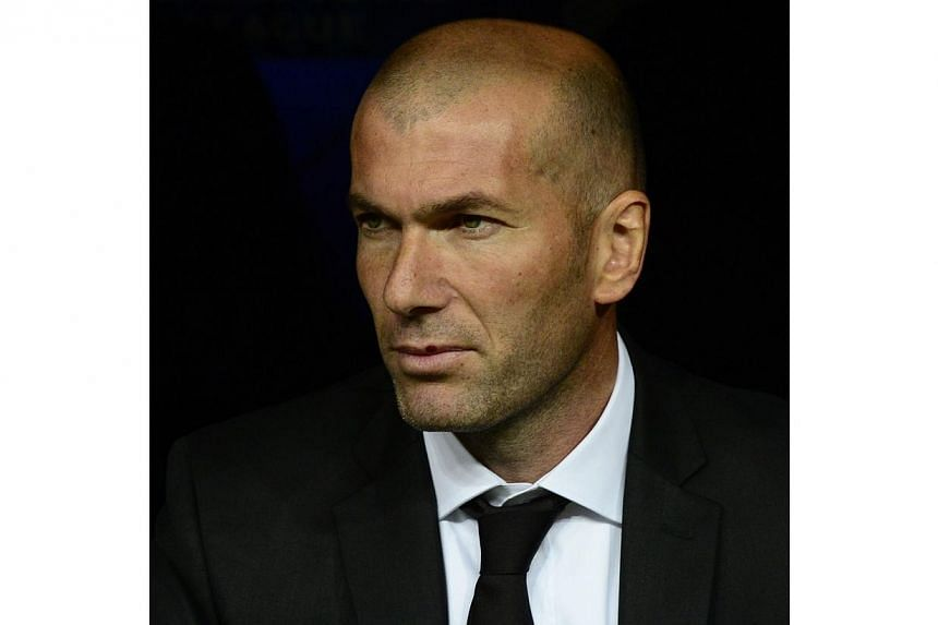 Real Madrid's assistant manager Zinedine Zidane looks on during the Uefa Champions League quarterfinal first leg football match Real Madrid FC vs Borussia Dortmund at the Santiago Bernabeu stadium in Madrid on April 2, 2014. -- PHOTO: AFP