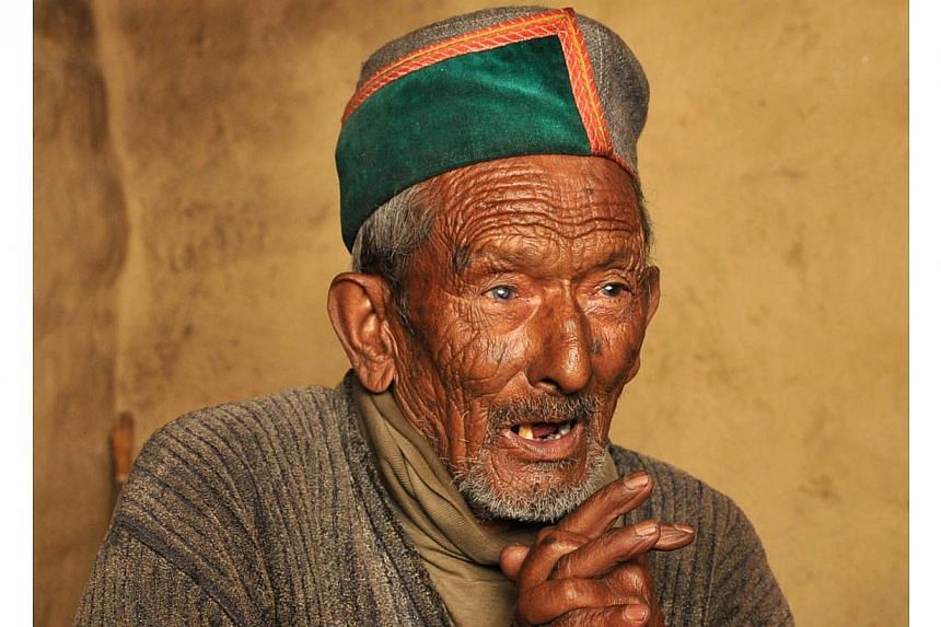 Ninety-seven year old Indian resident Shyam Saran Negi, gestures as he speaks at his home at Kalpa in Kinnaur District in the northern State of Himachal Pradesh, on April 24, 2014. As India held the latest round of its election Wednesday, 97-year-old