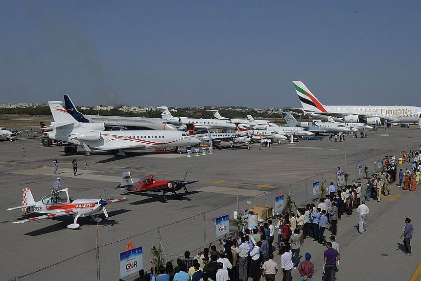 Various aircraft are seen on static display at the India Aviation 2014 airshow at Begumpet airport in Hyderabad on March 13, 2014. India's civil aviation regulator said on Wednesday it has set new rules for local airlines to ensure real time tra