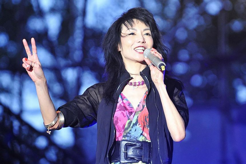 Hong Kong star Maggie Cheung at the Beijing segment of the Strawberry Music Festival.-- PHOTO:XINHUA