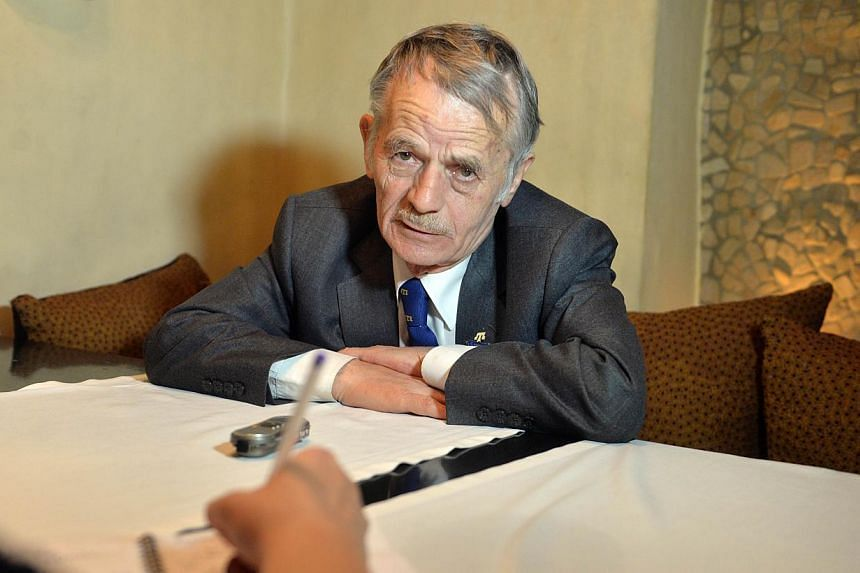 Mustafa Dzhemilev, historical leader of the Crimean Tatar National Movement and former Soviet dissident speaks to journalists during his interview for AFP in Kiev on May 6, 2014. Poland on Wednesday awarded a prize for championing democracy and human