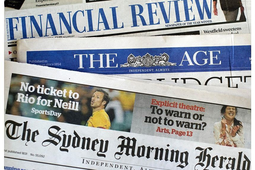 This photo illustration shows newspaper front pages of media group Fairfax in Sydney on May 7, 2014. Journalists at the Australian Financial Review, Sydney Morning Herald and Melbourne's The Age went on strike on Wednesday after management proposed a