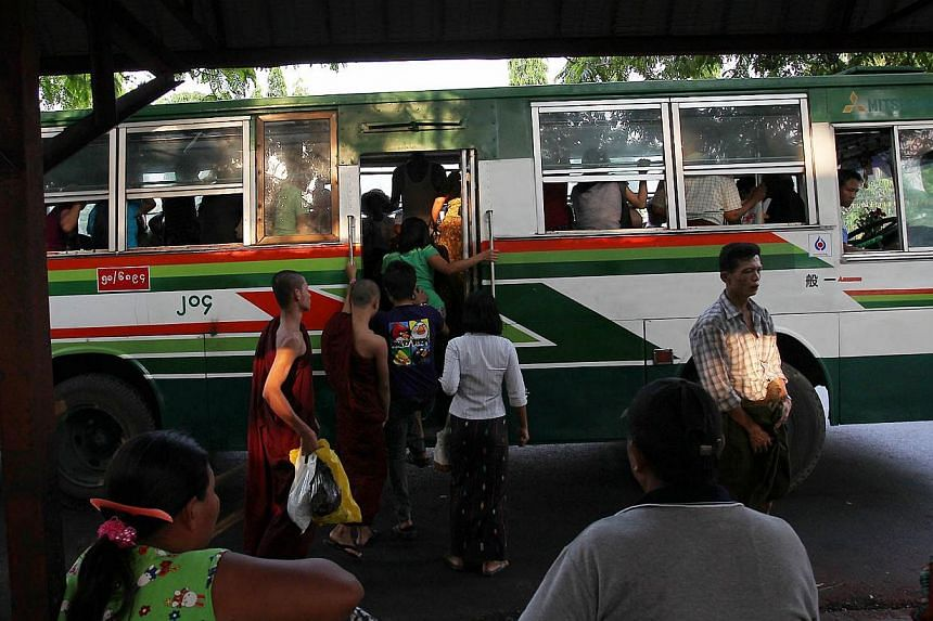 Myanmars board a bus at a bus stop in Yangon, Myanmar on March 29, 2012. -- ST FILE PHOTO:NEO XIAOBIN