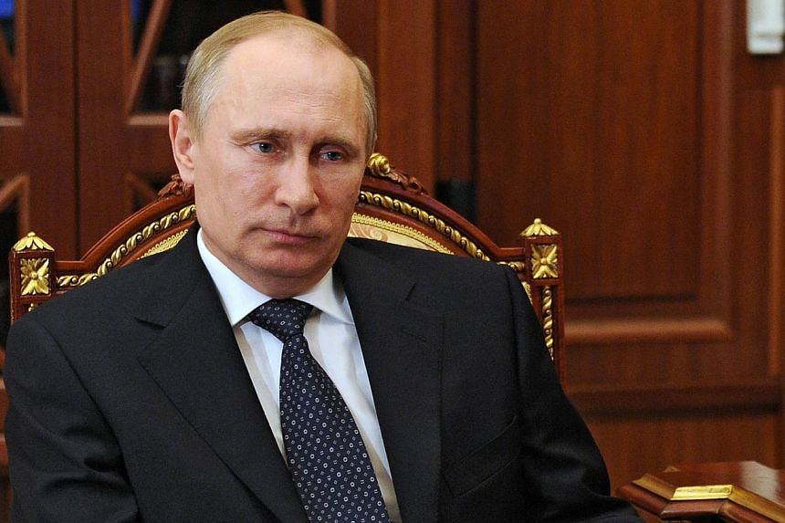 Russian President Vladimir Putin on Wednesday asked pro-Kremlin separatists in southeastern Ukraine to postpone a series of disputed referendums planned for this weekend on declaring greater autonomy or outright independence from Kiev. -- PHOTO: AFP