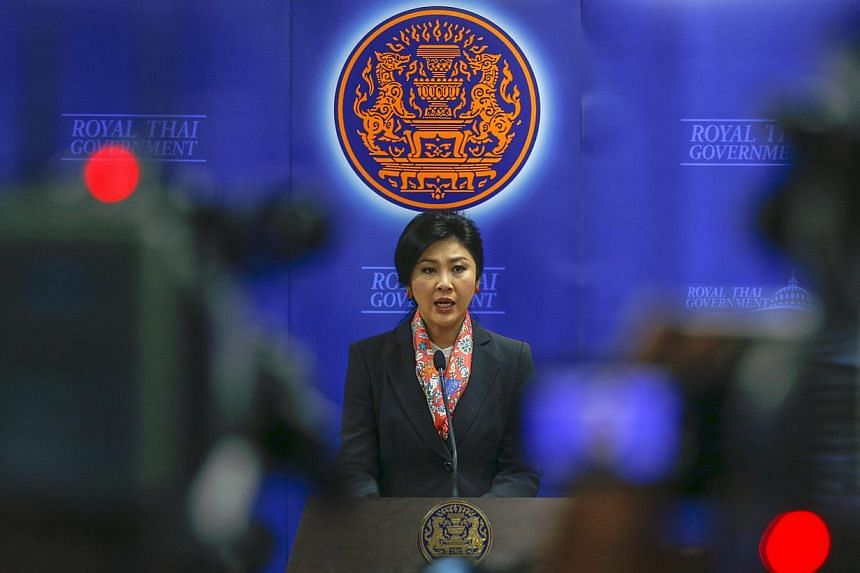 Thailand's Prime Minister Yingluck Shinawatra addresses reporters in Bangkok on May 7, 2014. The party of the ousted Thai prime minister issued a statement on Wednesday to denounce the constitutional court's ruling against Ms Yingluck Shinawatra as r