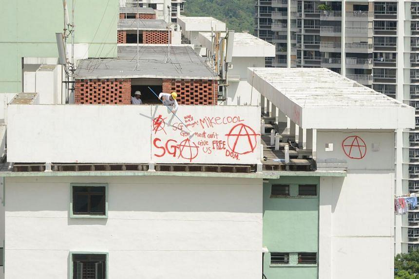 Graffiti sprayed at Block 85A Toa Payoh Lorong 4. -- PHOTO: WAN BAO