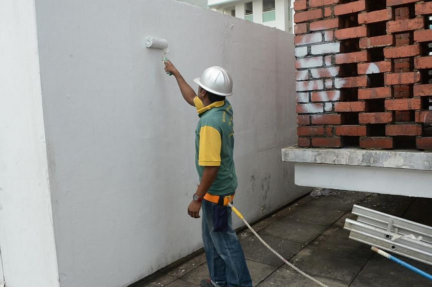 The defaced wall on the roof of Block 85A Toa Payoh Lor 4 was painted over by about 12 noon. -- PHOTO: WAN BAO