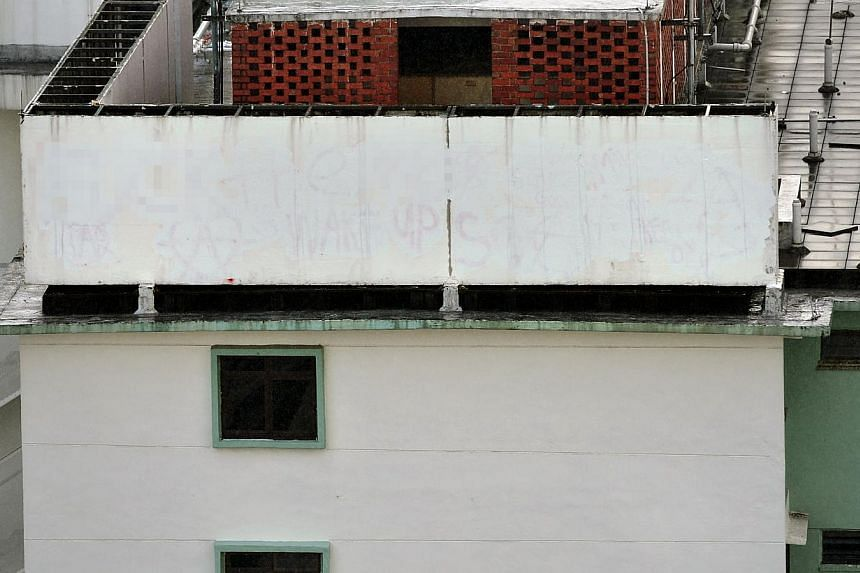 The defaced wall on the roof of Block 85A Toa Payoh Lor 4 was painted over by about 12 noon. -- ST PHOTO:KUA CHEE SIONG